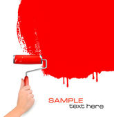 Hand with red roller painting the white wall Background vector — Vecteur