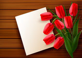 Red tulips and blank card on old wooden board. Vector. — Stock Vector