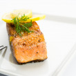 Delicious grilled salmon on a white plate - Photo
