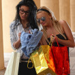 Two girls with vibrant shoping bags — Stock Photo #9459872