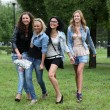 Happy four girls  in the spring park — Foto de Stock