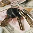 Money and keys - Stock Photo
