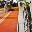 Men praying in a mosque - Stockfoto