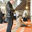 Men praying in a mosque — Stock Photo