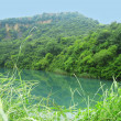 Stock Photo: Small lake between the caucasus mountains summertime