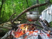 Water for tea boiling on the bonfire — Stock Photo
