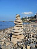 Balanced stones on the seashore — Stock Photo