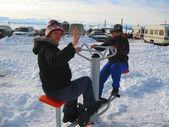 Two girls training on the winter ski apparatus — Stock Photo