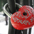 Locked wedding padlock on the handle of the bridge — Stock Photo