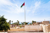 The Aqaba Flagpole under ruins of medieval Mamluks fort — Stock Photo