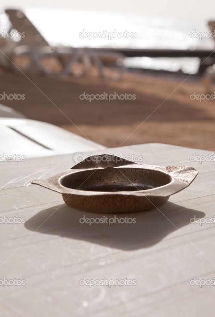 Old rusty ashtray on Read Sea beach in retro style  Stock Photo #10285795