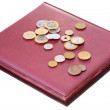 Different coins on red numismatics album — Stock Photo #10532726