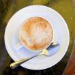 Cup of cappuccino on stone table — Stock Photo