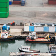 Stockfoto: Boats and freight containers in cargo port