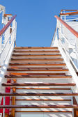 Wooden steps and blue sky — Stock Photo