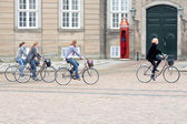 Bicyclists on square in Amalienborg Palace — Stock Photo