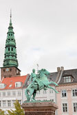 Tower St. Nicholas Church and Statue of Absalon in Copenhagen — Stock Photo