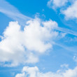 Big white clouds in blue summer sky — Stock Photo