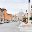 View on St.Peter Basilica from via Conciliazione in Rome - Foto Stock