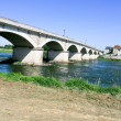 Highway bridge through wide river - Stock Photo