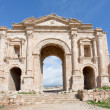 Arch of Hadrian in antique city of Gerasa Jerash in Jordan - Stock Photo