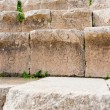 Ancient greek numbers on stone seats in antique Large South Theatre, Jerash — Stock Photo
