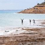 In mineral mud in Dead Sea, Jordan — Stock Photo #9402011