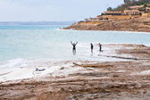 In mineral mud in Dead Sea, Jordan — Stock Photo