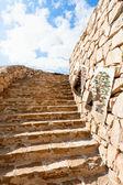 Bedouin carpets on stone wall in Jordan — Stock Photo
