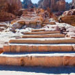 Antique sandstone steps on Facade Street in Petra — Stock Photo