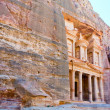 Treasury Monument in mount side of city Petra - Stock Photo