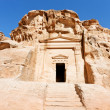 Ancient tomb near the entrance in Little Petra — Stock Photo