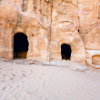 Cavern tombs near the entrance in Little Petra — Stock Photo #9930551