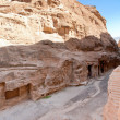Street with mountain caves - chambers in Little Petra — Stock Photo