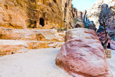 Eroded sandstone rocks and clored montains in gorge Siq — Stock Photo