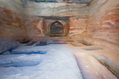 Interior of ancient tomb or dwelling in sandstone cave in Petra — Stock Photo