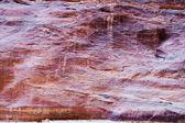 Multicolored sandstone wall of gorge Siq in Petra — Stock Photo