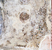 Ancient painted plaster on the ceiling of one of the caves in Little Petra — Stock Photo