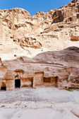 Ancient chambers in caves in Little Petra — Stock Photo