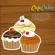 Stock Vector: Cupcakes on wooden