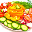 Vegetables on a plate on white — Stock Photo