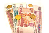 10 Rubles coins and different banknotes — Stock Photo