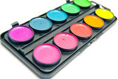 Box of colorful paints on white — Stock Photo