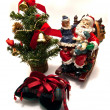 Santa , gift and Cristmas tree — Stock Photo #8089810
