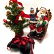 Santa , gift and Cristmas tree — Stock Photo