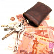 Bunch of keys and banknotes - Stock Photo