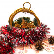 Cristmas basket, money and pinecones — Stockfoto