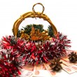 Cristmas basket, money and pinecones - Stock Photo