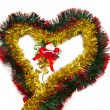 Heart of tinsel and Santa figurine - Stock Photo