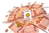 Ten rubles coins and five thousand banknotes — Stock Photo